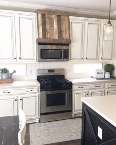 Faux Oven Hood @ourfauxfarmhouse Made from pallet wood. Farmhouse Kitchen Antiqued Cabinets