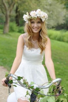 Keep it natural and like your hair down - adorn with a flower crown for additional bohemian vibes