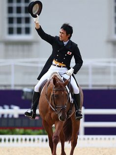 Yoshiaki Oiwa of Japan riding Noonday de Conde goes into the lead after the Dressage phase of the Eventing competition
