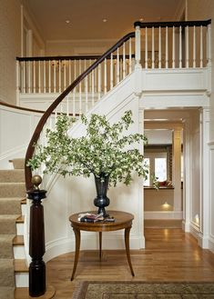 neutral stair runner that doesn't compete with foyer rug