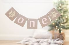 One     So perfect for party decor, highchair banner and for use as a photo prop! ♥ Measures about 20 inches long.    Lettering: Soft Pink
