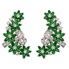Emerald Baguette and Round Diamond Gold Floral Design Earrings | From a unique collection of vintage more earrings at https://www.1stdibs.com/jewelry/earrings/more-earrings/