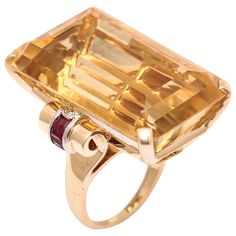 Retro Citrine Topaz Ruby Diamond Gold Cocktail Ring. 14kt Rose Gold Retro mounting with scroll with shank set with a bezel set Diamond and natural Channel cut Rubies in White Gold.. Very Hollywood and powerful.