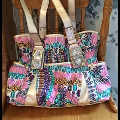 Kathy Van Zeeland Jem&Jive Belt Shopper I only used this for about a week and it's in excellent condition. Stunning jewel print with a pearly trim and hardware embellishments! This retailed for $89 and is certainly not the low quality one found in Walmart now. Kathy Van Zeeland Bags Shoulder Bags