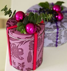 Printed decorated tins are great for goodies and with ribbon and a decoration on top they are super cute
