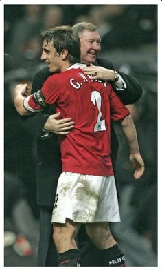 Ferguson embraces Gary Neville after United's 4-0 rout of Wigan in the 2006 League Cup final. Neville's first trophy as United captain, it kick-started a dominant three years for the Reds. One of SAF's favourite United photographs, auctioned for Unicef.