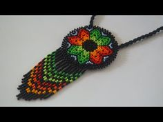 Кулон из бисера. Уичольские мотивы. Бисероплетение. Мастер класс - YouTube Bead Crafts, Jewelry Crafts, Bead Loom Patterns, Woven Bracelets, Handmade Beads, Beads And Wire, Beading Tutorials, Loom Beading, Beaded Flowers