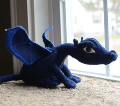 Free knitting pattern for Terry Pratchett's Discworld: Flynn the Swamp Dragon - Steph Conley designed this dragon softie inspired by Terry Pratchett's Discworld novels. Pictured project by nysak who added coated wire to give structure to the wings.