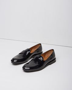 Jill Sander, black, patent loafers, $750. Image via La Garçonn