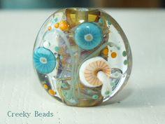 Handmade Lampwork Focal bead - 'Funky Mushroom' - Creeky Beads SRA by CreekyBeads on Etsy https://www.etsy.com/uk/listing/245918122/handmade-lampwork-focal-bead-funky