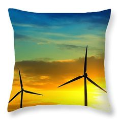 "Wind and sun energy Throw Pillow 14"" x 14"". Two windmills producing green energy during sunset showing a cloudscape with vibrant sky colors."