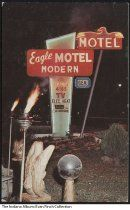 Eagle Motel, Indianapolis, Indiana, ca.1960 - Postcard of the electric sign for the Eagle Motel. There are lawn ornaments and statues, and two lit tiki torches.