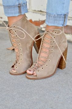 These high heel booties are made from soft vegan suede and feature a lace up upper with gold rings. Back zipper for easy on/off. All man-made materials. *Runs true to size. If between sizes, go a half size up.