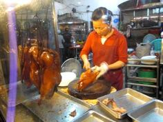 Lady Cuts Up A Roast Duck in  KaoHsiung, Taiwan