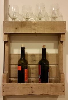 Weathered Pallet Wine Rack  These Weathered Pallet Wine Racks are designed to hold up to 4 wine bottles on the bottom shelf and up to 4 wine glasses on the top.