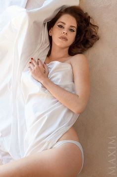 "Lana on Maxim--Songstress Lana Del Rey strips down to her underwear for the December/January 2014-2015 cover shoot from Maxim Magazine. The ""Ultraviolence"""