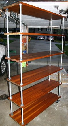 threaded rod shelving | Threaded rod shelves with casters.