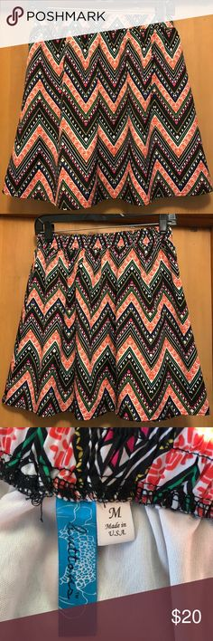 Boutique Multi-Color Mini Flowy Skirt Super fun, bright & colorful skirt with adorable pattern. In great condition, only worn 1-3 times. Great for night out or even wear to work! Skirts Mini