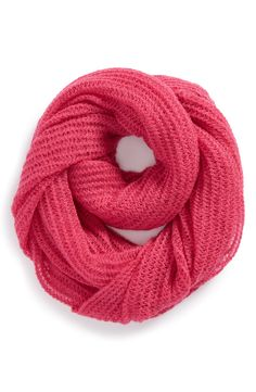Wearing this classic knit infinity scarf with jeans and a sweater.