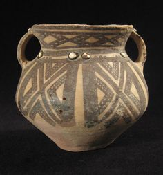 "An intriguing miniature painted pot from China. Measuring 4.5"" high by 5"" wide, it is studded with inlaid bits of bone or shell. Ex Joseph Gerena. QiJia culture, Inner Mongolia. Circa 2000-1700 B.C"