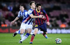 FC Barcelona's Lionel Messi, from Argentina, right, duels for the ball against Real Sociedad's Carlos Martinez during a Copa del Rey...
