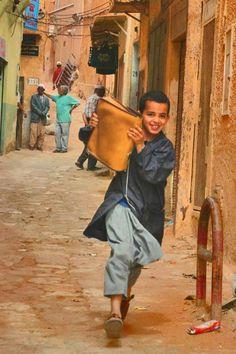 Ghardaia, Algeria -- running after school with his school bag