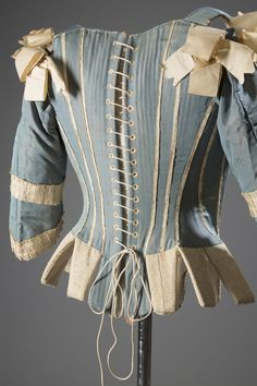 """Stays—otherwise known as whalebone corsets—were everyday wardrobe staples for """"proper"""" women of the eighteenth century. Yes, these undergarments don't look like the sexy bustier-corsets of today, but they were essential in moldingthe ideal body form: a tiny waist and pushed-up breasts. As Colleen Hill notesin Exposed: A History of Lingerie, the French ceremonial ritual of the toilette, a morning routine ofundressing and dressing in front of the court, involved putting on a stay. Women ..."""