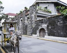"""Intramuros is a great introduction to what the Philippines is about. Explore this city within the walls in this first installment of my """"A Tourist In Intramuros"""" series. Philippine Holidays, Intramuros, Filipino, Street View, Manila Philippines, Explore, Landscape, City, Nature"""