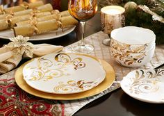 When holiday entertaining calls for fine wine and a little black dress, here's the dinnerware that's designed to do the evening justice. Each piece of this gorgeous glazed white china is accented with an elegant scalloped edge and a gold scroll design—a Pier 1 exclusive.