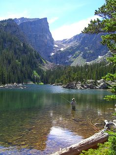 Woman fly fishing at Dream Lake in Rocky Mountain National Park, Colorado. Photo by Britta Campbell Copt
