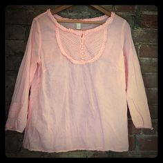 Last Chance🌿Donating soon🌿J. Crew blouse 🌻🌻🌻🌻🌻J.Crew shrimp colored blouse. Difficult to photograph it's color. Very lightweight 100%cotton. In excellent condition. 3/4 sleeves. Pleated accent around neck and on chest. Covered buttons on front and arms. J. Crew Tops Blouses
