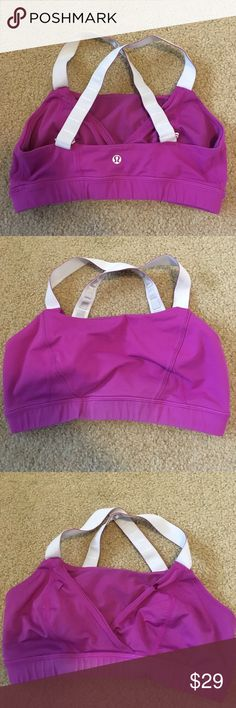 Lululemon sport bra Preowned and good condition fuchsia adjustable cross strap Lululemon bra fits size 6. Bundle to save big!! lululemon athletica Tops