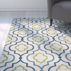Spruce up your alfresco space for the season with this eye-catching area rug! Made in India, this eclectic accent is power-loomed of 100% polypropylene for a low pile height and a design that can stand up to UV light damage. Roll it out by the pool to anchor a pair of cozy loungers, then play into its cool blue- and green-hued quatrefoil motif with glossy garden stools. In need of an entryway update? Just bring this beauty inside for a fashion-forward foundation that will effortlessly endure…