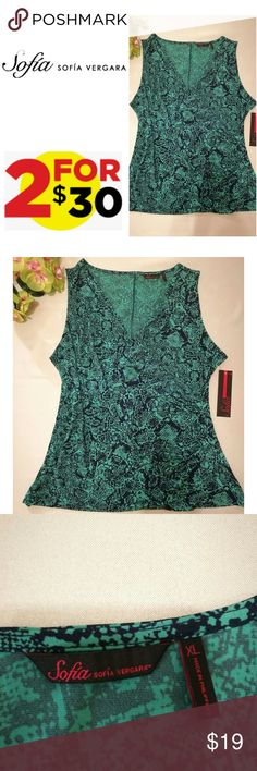 🎉SALE🎉 2FOR$30 Sleeveless Faux Wrap Top XL Beautiful navy and green print. Lightweight soft fabric which drapes to enhance your figure.   Looks great dressed up or worn casual. In mint condition.  Tag still attatched.  Comes from a smoke free home.  Check out my closet.  Reasonable offers always welcome.  Beautiful items in a variety of styles and sizes.  Shop for yourself and a loved one.  Add to Bundle for discount, plus savings on shipping🔥 sofia by sofia vergara Tops Blouses