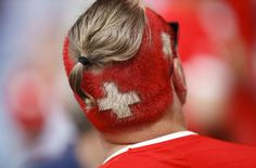 A Swiss fan, the colors of the national flag painted on his head, waits for the start of the Euro 2016 Group A soccer match between Romania and Switzerland at the Parc des Princes stadium in Paris, France, Wednesday, June 15, 2016. (AP Photo/Christophe Ena)/FP190/821882217076/1606151735