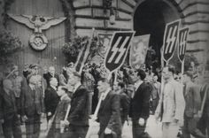 Ukrainian Nazis march at unidentified location to show their solidarity to Ukrainians fighting with the Waffen SS. The 14th Waffen Grenadier Division of the SS (1st Galician) (German: 14. Waffen Grenadier Division der SS (galizische Nr.1) was the main formation manned with Ukrainian volunteers. Thousands of other Ukrainian volunteers served as Nazi auxiliaries as concentration camp guards and occupation police.