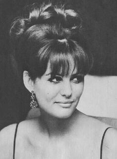 Claudia Cardinale's gorgeous 1960's up do with fall. You have to use some fake hair for this, so awesome!