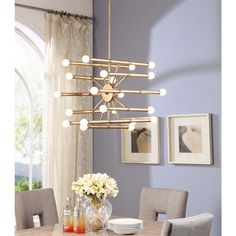 Add an eye-catching element to your home decor with this modern chandelier, finished with a brushed goldtone finish. The bar style holds twenty two bulbs that illuminate soft light.