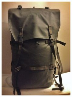 1990's Swiss army rubberised, waterproof patrol pack - expandable with compression straps and webbing loops: the internal frame support strips can be removed to collapse the pack down to a very small size.