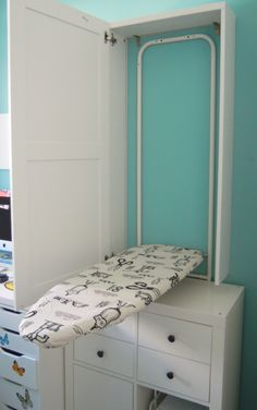 Ironing board cabinet - hang our over the door iron on the wall instead of the the door. Also instead of Ironing board remove lower drawers and a sewing table comes down! Sewing Room Design, Laundry Room Design, Sewing Rooms, Diy Sewing Table, Diy Table, Ikea Ironing Board, Laundry Room Storage, Laundry Rooms, Ikea Laundry
