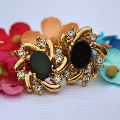 Classy, and beautiful - just like you. Centered with a black stone, gold tone starbursts out, and accented with six shiny rhinestones. Details Gorgeous vintage earrings, in great condition! Measure 1/