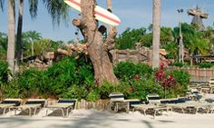 Sandy White Beach at Disney's Typhoon Lagoon Water Park lies in an area off the beaten path offering lounge chairs, hammocks, umbrellas and beautiful water views for a peaceful atomosphere to kick back and relax.