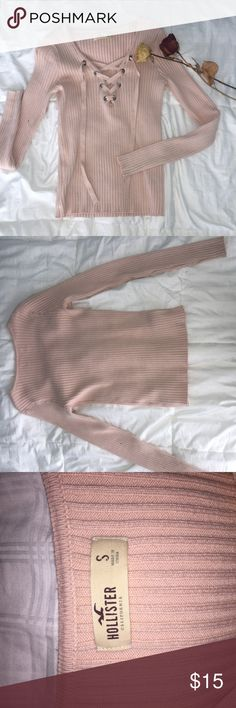 Hollister Tie-up Long Sleeve Shirt This baby pink tie-up shirt can easily be dressed up and worn with heels for a night out. The material is thick and it fits well as a small. Hollister Tops Tees - Long Sleeve
