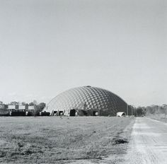 Buckminster Fuller, Union Tank Car Company Repair Shop Buildings, (1956-1957)  The dome's circular plan could be organically derived from it's function in the building, as the tracks for the tank cars to be repaired were arranged like spokes of a bicycle wheel around a central parts and office area; a circular transfer table advanced the vehicles.