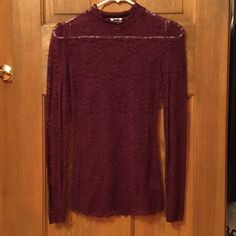Free people lace top Maroon lace see through top. Sized more like a small then an extra small Free People Tops Blouses