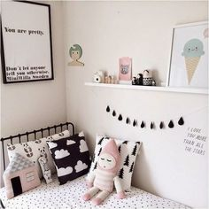 A cute room for a little girl - black and white with pops of pink:
