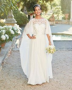 Joanna Hope Cape Bridal Dress. This stunning dress is guaranteed to turn heads. Part of our bridal range this Joanna Hope gown is crafted in a soft chiffon and lined with stretch satin lining. It comes with cape detail to the back and lace detail to the bodice.{affiliate link} #bridalgown #weddingdress