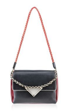 This shoulder bag by Sara Battaglia is rendered in black and red calf leather and features a chain top handle, woven leather detachable shoulder strap with silver stud detailing. Fall-Winter 2015 (=)