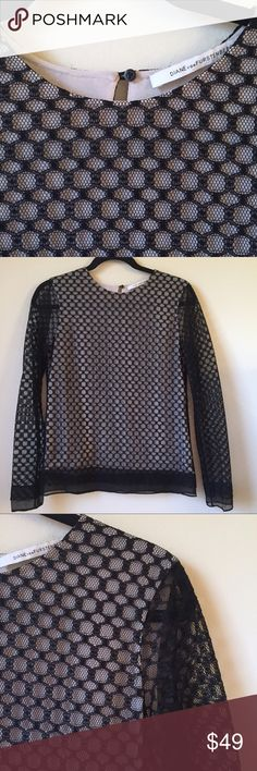 Diane Von Furstenberg lace overlay top- like new DVF top has black lace all over with a nude panel in front and back so no cami needed. The back has a button closure. Classic style. Only worn once so perfect condition! Diane von Furstenberg Tops