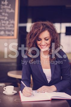 Woman writing in a notebook royalty-free stock photo